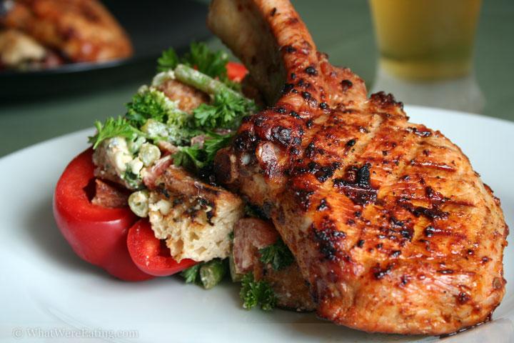 greek-salad pork chop covered slice tomato marinated mushrooms mayonnaise cheese