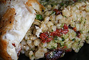Pesto, sun-dried tomato, and olive barley salad