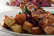 Roasted potatoes and turkey kabobs